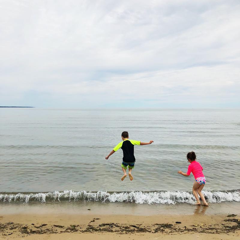 Kids-Jumping-At-Beach