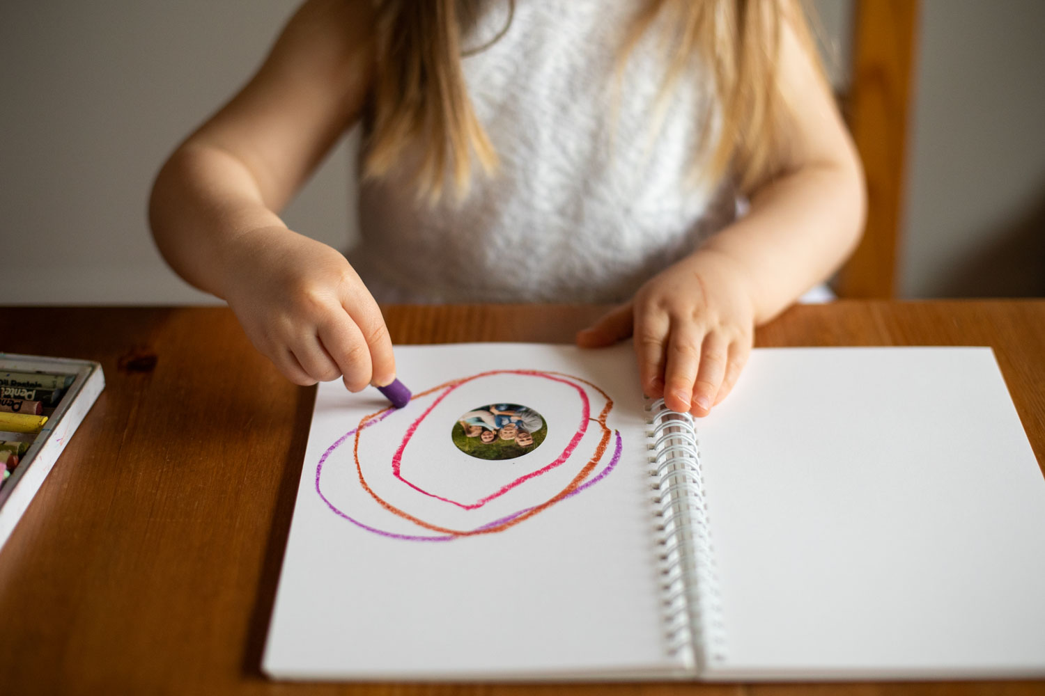 child-drawing-in-notebook
