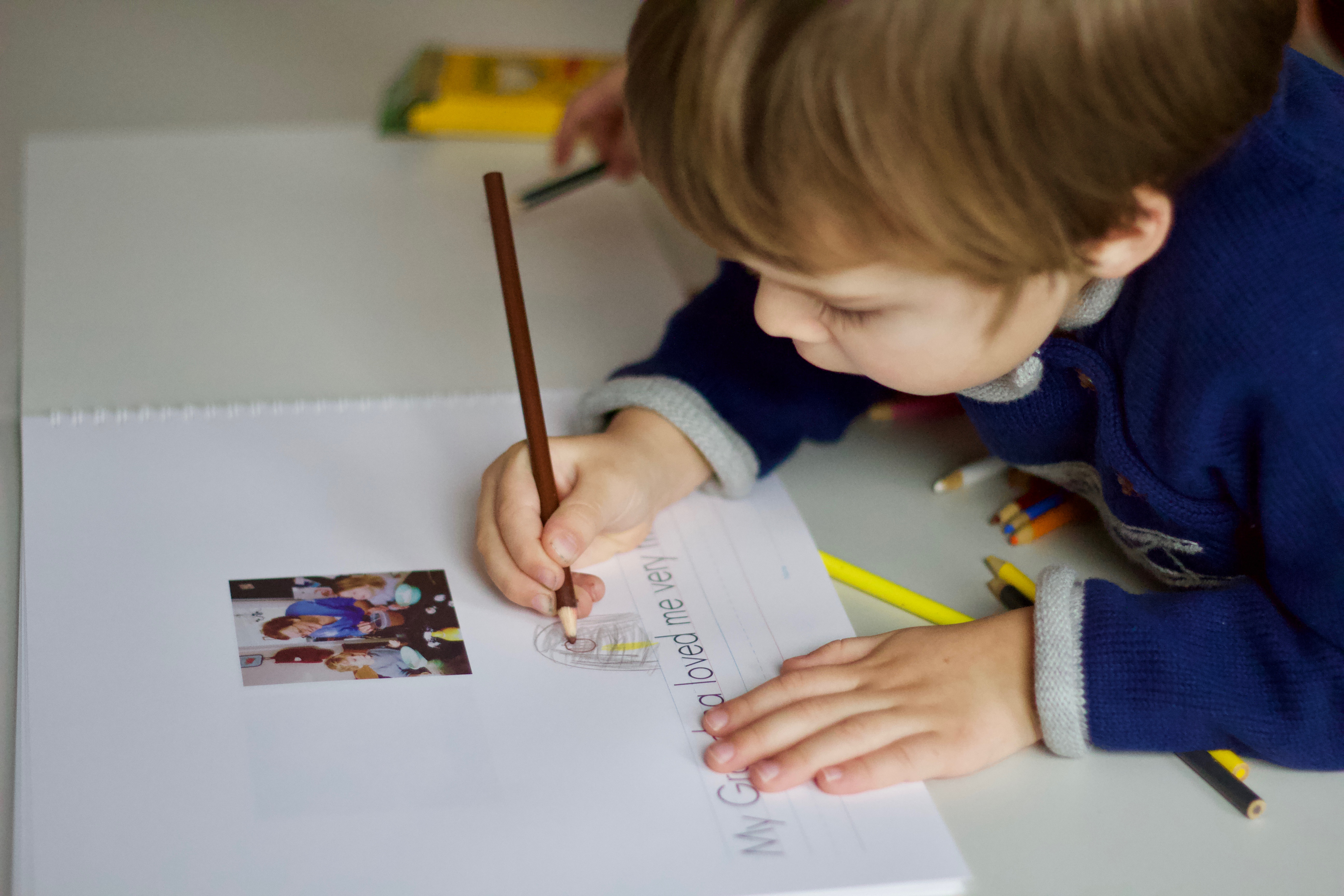 Child-drawing-in-personalized-notebook
