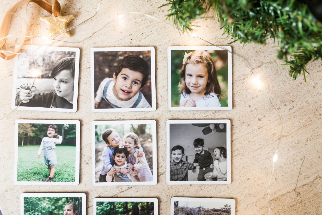 set of six photo magnets featuring photos of young kids and families